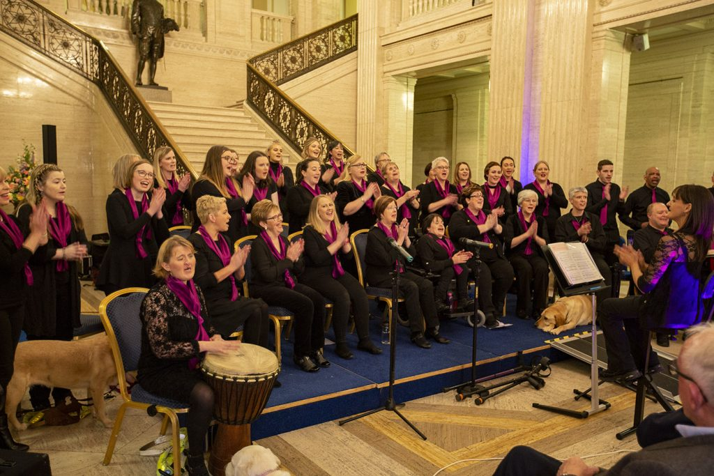 Choir at the foot of the stairs in the main hall of Stormont