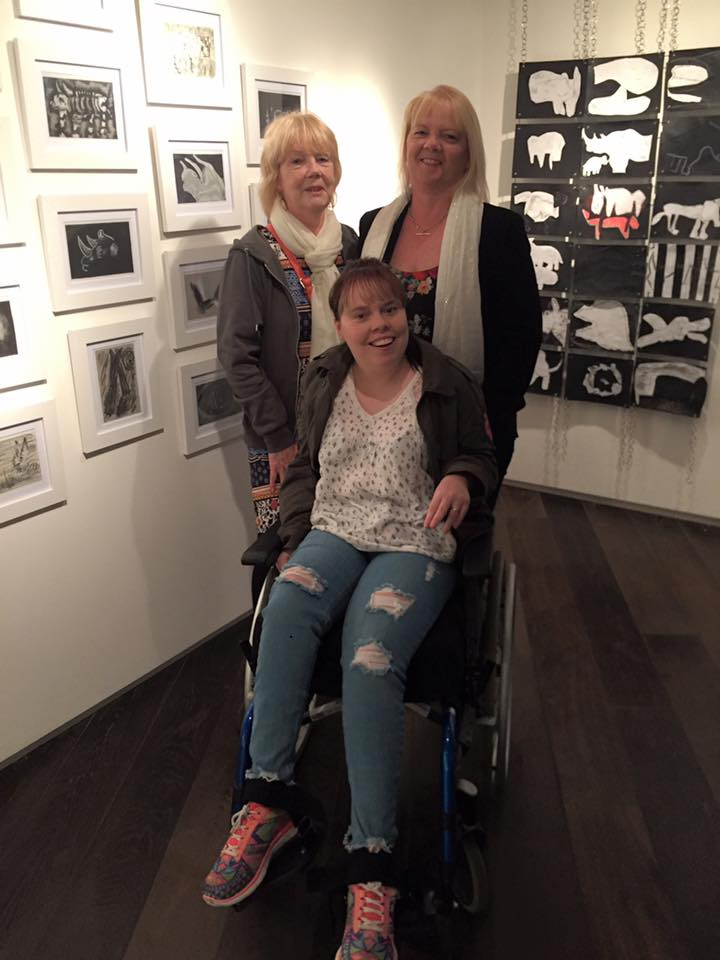 Three women in front of two exhibition pieces at launch of exhibition at MAC Theatre, Belfast in 2017.
