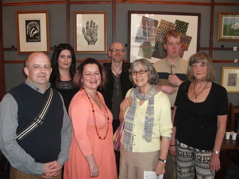 Group picture of two facilitators and four members of the Open Arts visual art group at the launch evening in Linen Hall Library 2013.